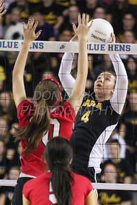 Padua's #4 Allyson Jennings sends the ball over as Ursuline's #10 Lily Kramp tries to block during the Girls State Volleyball Championship at the Bob Carpenter Center, Monday, November 11, 2012. photo/www.DonBlakePhotography.com