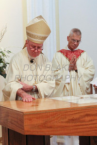 Bishop Malooly anoints the alter with Chrism Oil during the rededication mass at St. Catherine of Siena Church, November 18, 2012. photo/www.DonBlakePhotography.com