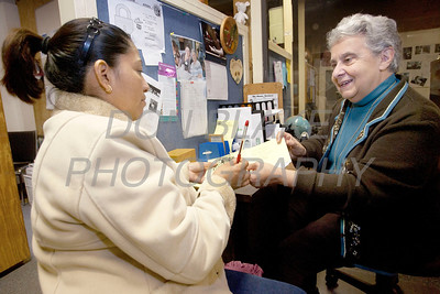 St. Patricia Gamgort who help start St. Martin's Barn 29 years ago (right) meets with client Maricela Lopez-Cancino at St. Martin's Barn. photo/Don Blake Photography.com