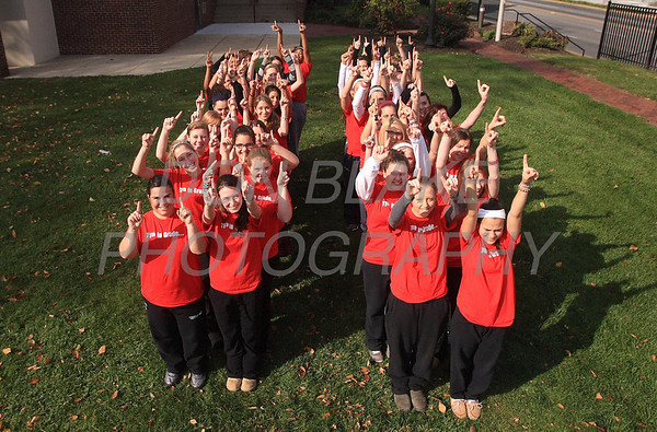 The 11th grade class at Ursuline Academy stand in the shape of 11 at 11:11 on 11/11/11. photo/DonBlakePhotography.com
