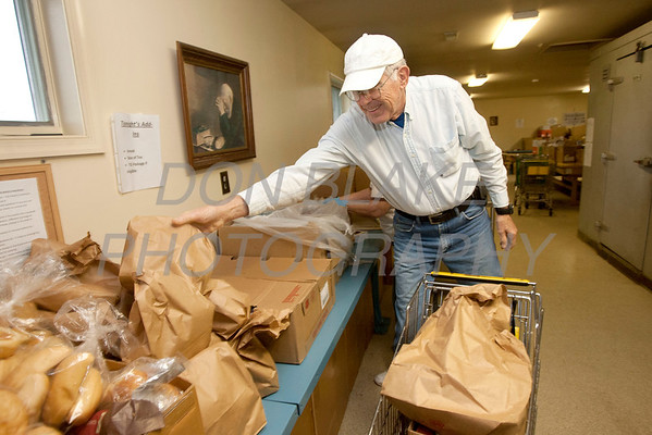 Ken Swain prepares food for the clients at St. Martin's Barn. photo/Don Blake Photography.com