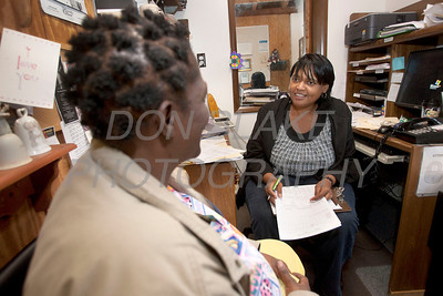 Odette Boyce-Galvez manager of St. Martin's Barn (right) meets with client Lea Simms in her office at St. Martin's Barn. photo/Don Blake Photography.com