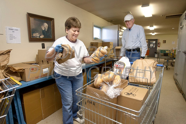 Carolyn and Ken Swain load food into a clients cart St. Martin's Barn. photo/Don Blake Photography.com