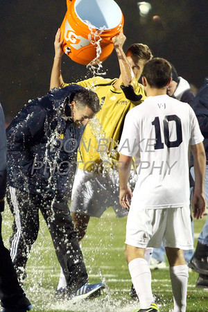 Sallies keeper Sean Mazzio douses coach Scott Mosier after winning the DIAA DIV I STATE CHAMPIONSHIP GAME at Smyrna High School, Saturday, November 16, 2013. wwwDonBlakePhotography.com