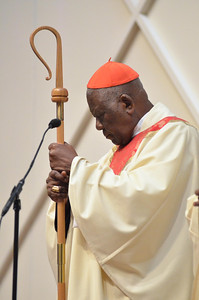 Cardinal Tumi listens to the gospel on the alter during mass at St. Elizabeth Ann Seton, Sunday, October 28, 2012. photo/www.DonBlakePhotography.com