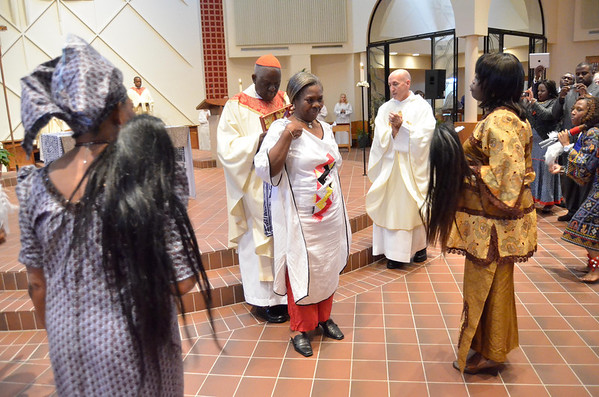 Parishioner dance and sing as the book of gospels is delivered to Cardinal Tumi on the alter during mass at St. Elizabeth Ann Seton, Sunday, October 28, 2012. photo/www.DonBlakePhotography.com
