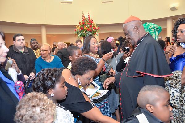 Cardinal Tumi greets parishioners after mass at St. Elizabeth Ann Seton, Sunday, October 28, 2012. photo/www.DonBlakePhotography.com