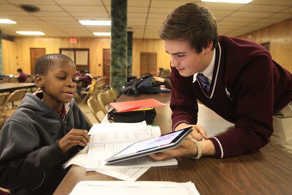 Zach Rivera helps 4th grader Christian Bessem-Asu with school work. www.DonBlakePhotography.com