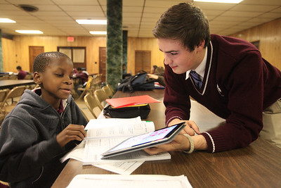 Zach Rivera helps 4th grader Christian Bessem-Asu with school work. www.DonBlakePhotography.com