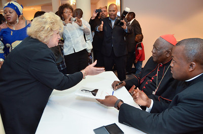 Cardinal Tumi greets parishioners and signs books after mass at St. Elizabeth Ann Seton, Sunday, October 28, 2012. photo/www.DonBlakePhotography.com