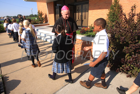 Bishop Malooly welcomes students as they arrive for the Rosary Rally at the Our Lady Queen of Peace statue on the grounds of Holy Spirit Church in New Castle, Friday, October 5, 2012. photo/ www.DonBlakePhotography.com