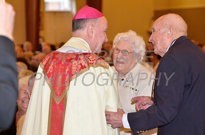 Virginia and William Miller from Holy Cross Parish who are celebrating their 70th are congratulated by Bishop Malooly during the Wedding Anniversary Mass at St. John the Beloved, Sunday, October 7, 2012. photo/ www.DonBlakePhotography.com