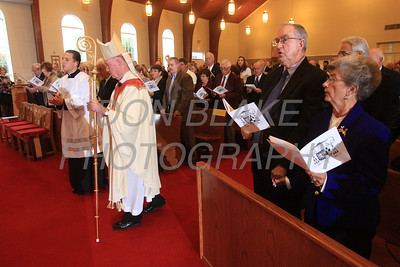 Bishop Malooly processes to the alter during the Wedding Anniversary Mass at St. John the Beloved, Sunday, October 7, 2012. photo/ www.DonBlakePhotography.com