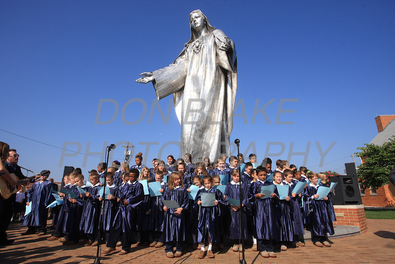 Students from St. Anthony School Choir sing during the Rosary Rally at the Our Lady Queen of Peace statue on the grounds of Holy Spirit Church in New Castle, Friday, October 5, 2012. photo/ www.DonBlakePhotography.com