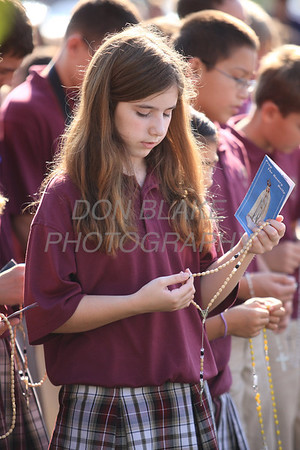Abigail Duggan 6th grade a student from Christ the Teacher Cathoilc School prays the rosary during the Rosary Rally at the Our Lady Queen of Peace statue on the grounds of Holy Spirit Church in New Castle, Friday, October 5, 2012. photo/ www.DonBlakePhotography.com
