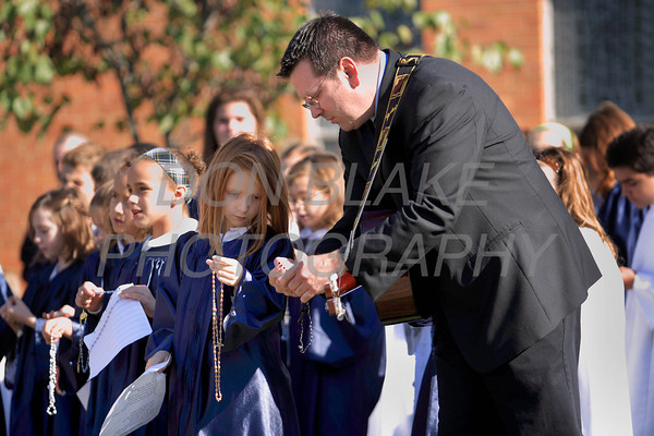 A student gets help with her rosary as Catholic school students from around the Diocese gather for the Rosary Rally at the Our Lady Queen of Peace statue on the grounds of Holy Spirit Church in New Castle, Friday, October 7, 2011. photo/Don Blake Photography