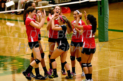 Ursuline celebrates after scoring a point during Ursuline's 25-23, 25-18, 25-22 win over St. Mark's at St. Mark's, Thursday, September 29, 2011. photo/Don Blake Photography