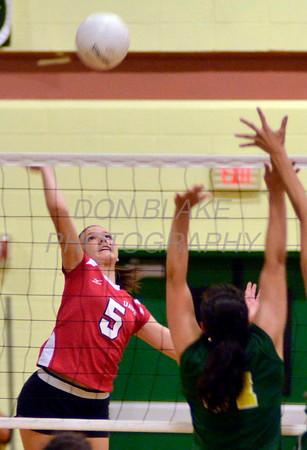 Ursuline's #5 Caroline Francois sends the ball over the net during Ursuline's 25-23, 25-18, 25-22 win over St. Mark's at St. Mark's, Thursday, September 29, 2011. photo/Don Blake Photography