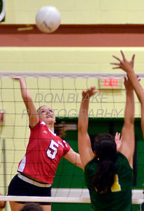 Ursuline's #5 Caroline Francois sends the ball over the net during Ursuline's 25-23, 25-18, 25-22 win over St. Mark's at St. Mark's, Thursday, September 29, 2011. photo/Don Blake Photography