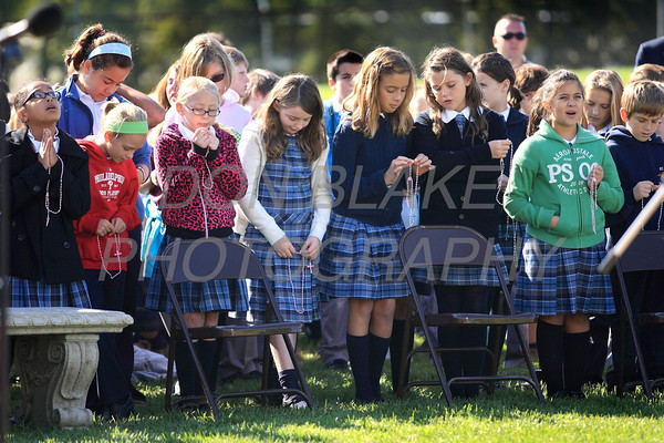 Students pray the rosary as Catholic school students from around the Diocese gather for the Rosary Rally at the Our Lady Queen of Peace statue on the grounds of Holy Spirit Church in New Castle, Friday, October 7, 2011. photo/Don Blake Photography
