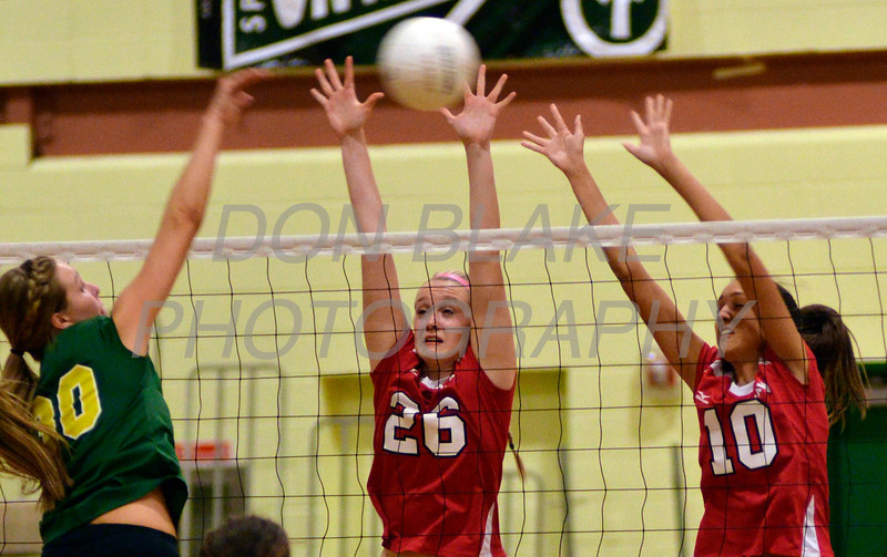 Ursuline's #26 Jillian Lyons and #10 Alexa Wick block the ball hit by St. Mark's #30 Abbie Mirabella during Ursuline's 25-23, 25-18, 25-22 win over St. Mark's at St. Mark's, Thursday, September 29, 2011. photo/Don Blake Photography