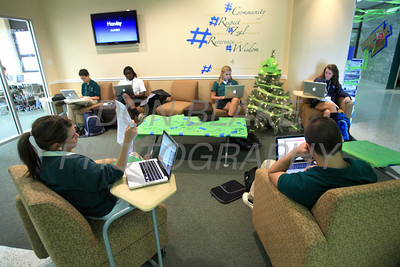 Archmere Academy students work on their school issued MacBook Pro's in the student lounge at Archmere Academy. photo/Don Blake Photography