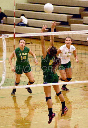 St. Mark's #5 Claudia Seemans sets the ball during Ursuline's 25-23, 25-18, 25-22 win over St. Mark's at St. Mark's, Thursday, September 29, 2011. photo/Don Blake Photography