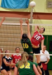 Ursuline's #18 Jessica Hires McKelvey hit the ball over the net as St. Mark's #10 Lauren Sorantino tries to block during Ursuline's 25-23, 25-18, 25-22 win over St. Mark's at St. Mark's, Thursday, September 29, 2011. photo/Don Blake Photography
