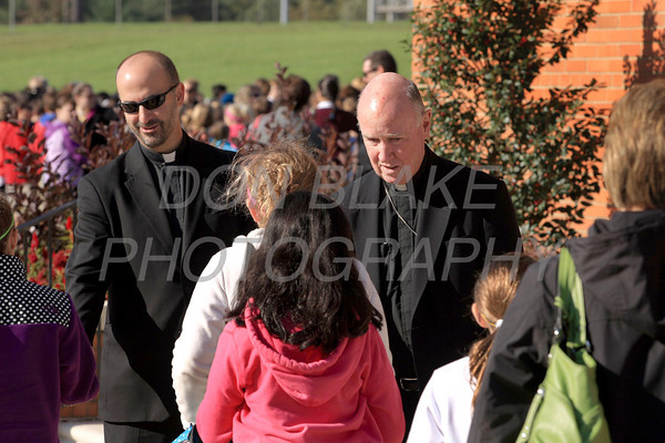 Fr. John Grimm and Bishop Malooly welcome students as they arrive for the Rosary Rally at the Our Lady Queen of Peace statue on the grounds of Holy Spirit Church in New Castle, Friday, October 7, 2011. photo/Don Blake Photography