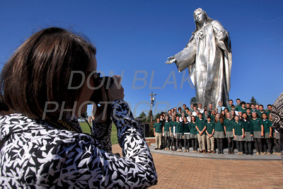 Students have their picture taken in front of the statue with Bishop Malooly as Catholic school students from around the Diocese gather for the Rosary Rally at the Our Lady Queen of Peace statue on the grounds of Holy Spirit Church in New Castle, Friday, October 7, 2011. photo/Don Blake Photography