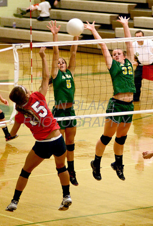 Ursuline's #35 Mary Abram hits ball over as St. Mark's #5 Claudia Seemans and #32 Jacqueline Thomson try to block during Ursuline's 25-23, 25-18, 25-22 win over St. Mark's at St. Mark's, Thursday, September 29, 2011. photo/Don Blake Photography