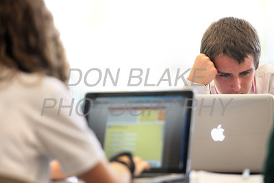 Archmere Academy 9th grade student Sean Devine works on his school issued MacBook Pro in the cafeteria at Archmere Academy. photo/Don Blake Photography