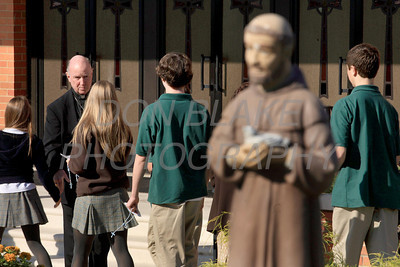 Bishop Malooly welcomes students as they arrive for the Rosary Rally at the Our Lady Queen of Peace statue on the grounds of Holy Spirit Church in New Castle, Friday, October 7, 2011. photo/Don Blake Photography