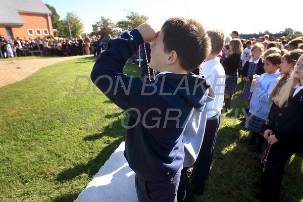 A student looks up at the statue as Catholic school students from around the Diocese gather for the Rosary Rally at the Our Lady Queen of Peace statue on the grounds of Holy Spirit Church in New Castle, Friday, October 7, 2011. photo/Don Blake Photography