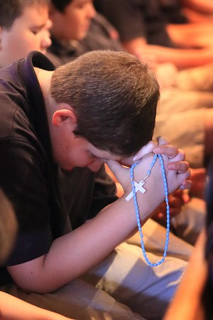 Hadyn Steteler 5th grader from All Saints Catholic School prays the rosary during the Student Rosary Rally at Holy Spirit Church, October 7, 2016. wwwDonBlakePhotography.com