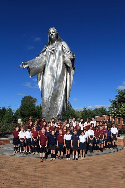 Students from St. Mary Magdalen as their picture taken in front of the Our Lady of Peace stauteafter the Student Rosary Rally at Holy Spirit Church, October 7, 2016. wwwDonBlakePhotography.com