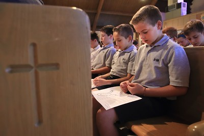 Immaculate Heart of Mary School 5th grade students L to R Matthew Copeland, Shane Olexa, and Micvhael Gioia pray the rosary during the Student Rosary Rally at Holy Spirit Church, October 7, 2016. wwwDonBlakePhotography.com