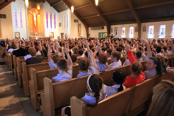 Students hold up their rosary as they blessed during the Student Rosary Rally at Holy Spirit Church, October 7, 2016. wwwDonBlakePhotography.com
