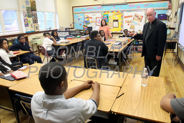 Bishop Malooly talks with the 8th grade class at Cathedral of St. Peter School during his annual visit Thursday, October 10, 2013. wwwDonBlakePhotography.com