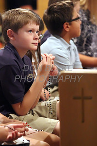 Wegley Aubuchon 5th grader from Holy Angels School prays the rosary along with other students from around the Diocese during the Youth Rosary Rally at Holy Spirit Church. www.DonBlakePhotography.com