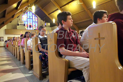 Justin Lawson 9th grader from St. Elizabeth High School prays the rosary along with other students from around the Diocese during the Youth Rosary Rally at Holy Spirit Church. www.DonBlakePhotography.com