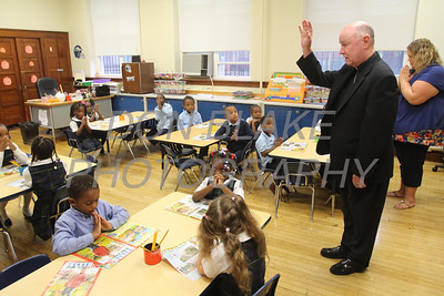 Bishop Malooly blesses the Kindergarden class at Cathedral of St. Peter School during his annual visit Thursday, October 10, 2013. wwwDonBlakePhotography.com