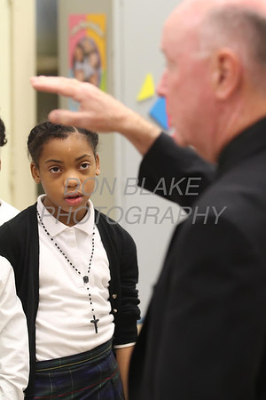Halle Morris wears her rosary as Bishop Malooly blesses the 4th grade class at Cathedral of St. Peter School during his annual visit Thursday, October 10, 2013. wwwDonBlakePhotography.com