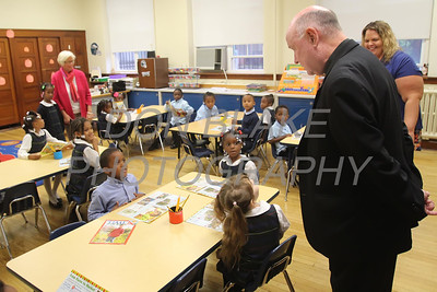 Bishop Malooly talks with the Kindergarden class at Cathedral of St. Peter School during his annual visit Thursday, October 10, 2013. wwwDonBlakePhotography.com