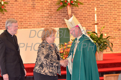 Bishop Malooly shakes hands with award recipient Dolores Nolan of Resurrection Parish during the Medal of Merit award ceremony at St. John the Beloved, Sunday, October 21, 2012. www.DonBlakePhotography.com