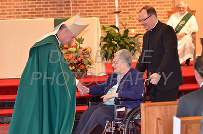 Bishop Malooly shakes hands with award recipient Eleanor Reilly of Immaculate Conception Parish during the Medal of Merit award ceremony at St. John the Beloved, Sunday, October 21, 2012. www.DonBlakePhotography.com