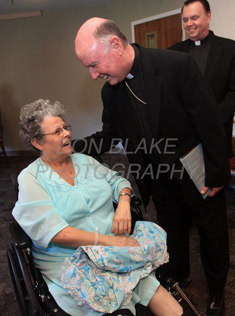 Grace Larotonda from St. Mary of the Assumption Parish is surprised by Bishop Malooly who delivered her Order of Merit to her at Franciscan Care Center at Brackenville, Sunday, October 16, 2011. Grace was injured recently and could not attend the Order of Merit Service at St. John the Beloved Church. The Dialog/Don Blake