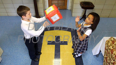 Fouth graders Tyler Hurd and Taina Black toss the Cube of Love at St. Peter the Apostle School. wwwDonBlakePhotography.com