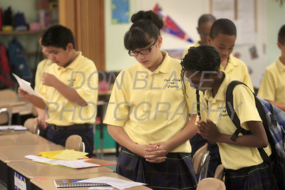 Former St. Paul student Felicity Rodriguez (left) shares her morning prayer paper with Christen Spence during homeroom in Mrs. Foran 6th grade class at Our Lady of Fatima School, Thursday, August 25, 2011. The Dialog/Don Blake