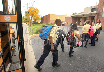Former St. Paul students exit the bus and enter Our Lady of Fatima School, Thursday, August 25, 2011. The Dialog/Don Blake